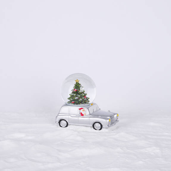 Santa Speeder Snow Globe